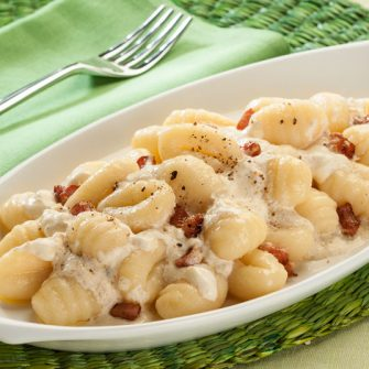 Potato gnocchi with bacon and Robiola with Artichoke and Thyme