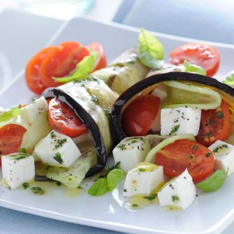 Aubergine rolls with Primosale, cherry tomatoes and basil