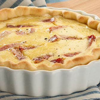 Robiola with Artichoke and Thyme quiche with sticks of Prague ham