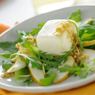 Robiola with pears, rocket and walnut sauce