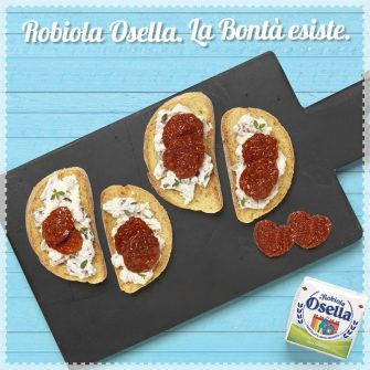 Bruschetta with Robiola, dried tomatoes, olives and almonds