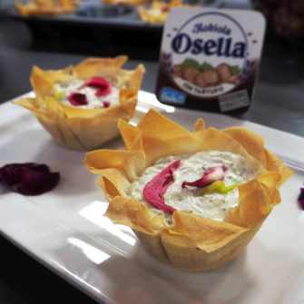 Mini filo pastry baskets filled with radicchio, thyme and Robiola Osella with Truffle